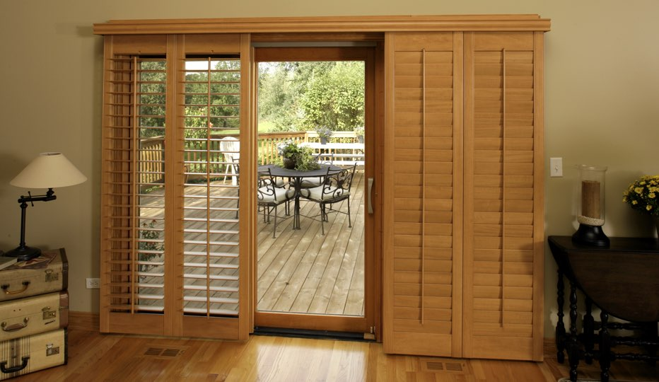 Wood bypass patio door shutters in Honolulu living room